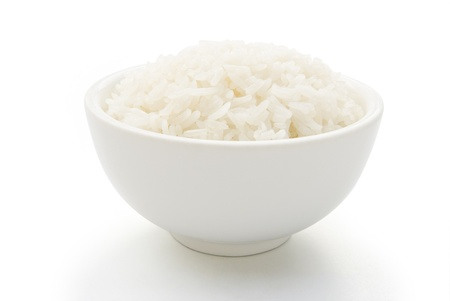bowl full of rice on white with clipping path Stock Photo