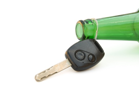 drunk driving conceptual, key and beer bottle with clipping path photo