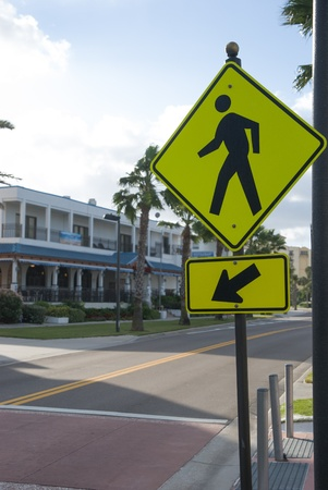 cross street with care: traffic sign for pedestrian crossing