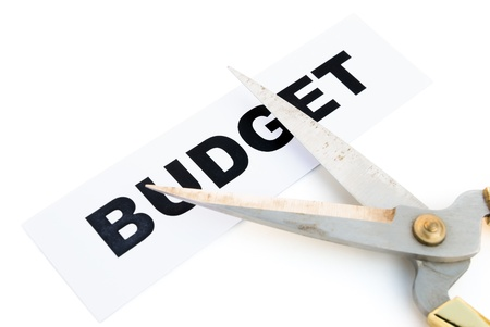 balanced budget: tag of budget and scissors with clipping path