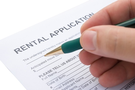 sign contract: filling a rental agreement application Stock Photo