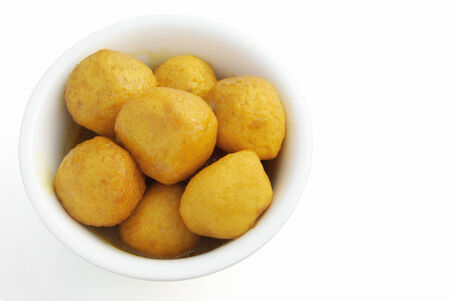 fish in ball: top view curry flavor fish balls in bowl with clipping path Stock Photo