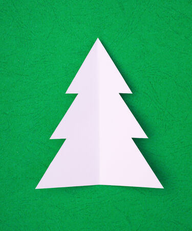 hand cut christams tree on green photo