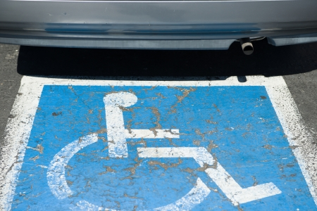 car and car park sign for disabled driver