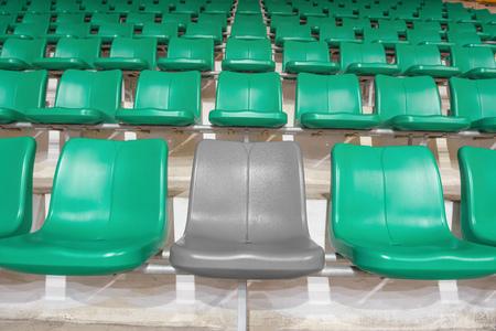 sequential: grey stadium seat between green seats