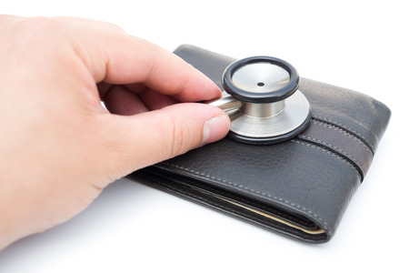diagnosing: diagnosing a wallet on white background Stock Photo