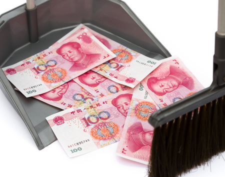 valorization: RMB in rubbish bin and a  besom, monetary concept