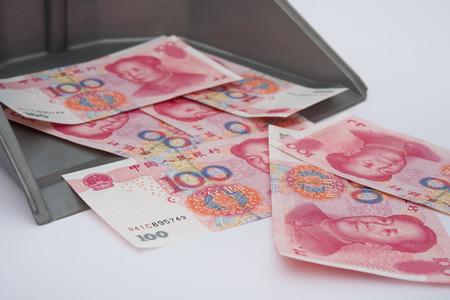 monetary concept: RMB in rubbish bin, monetary concept