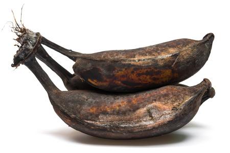 moulder: black overripe bananas on a white background