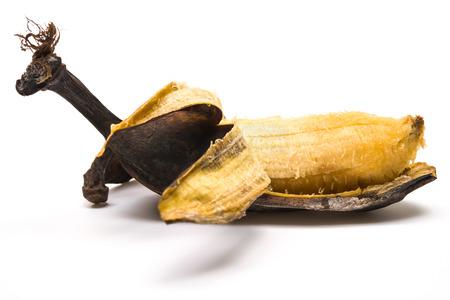 moulder: peeled overripe banana on a white background