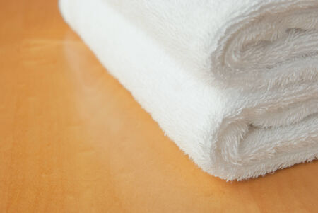 white towel on wooden panel with copy space Stock Photo
