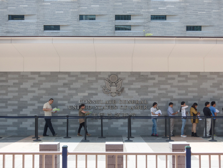 immigrate: GUANGZHOU, CHINA - September 4 USA consulate on September 4, 2014 in Guangzhou, China. People standing in a queue in front of The Consulate General of United States, applying USA Visas.
