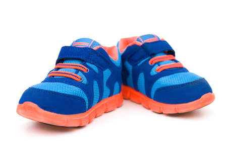pair of blue sporty shoes for kid on white stock photo picture and
