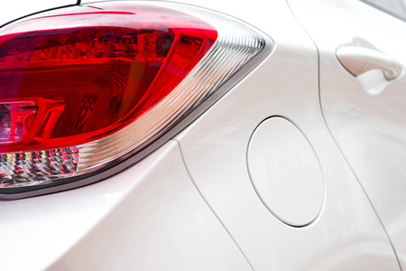 taillight: close up look of a taillight of a white car