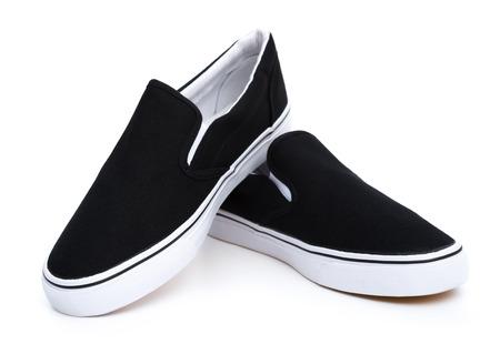 athletic wear: pair of black sneakers on white