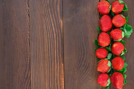 fruity salad: top view strawberries on wood