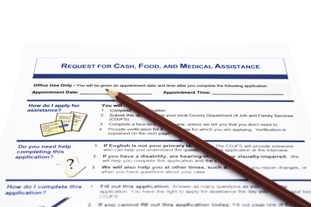 medical assistant: request for cash food and medical assistant application form and a pencil Editorial