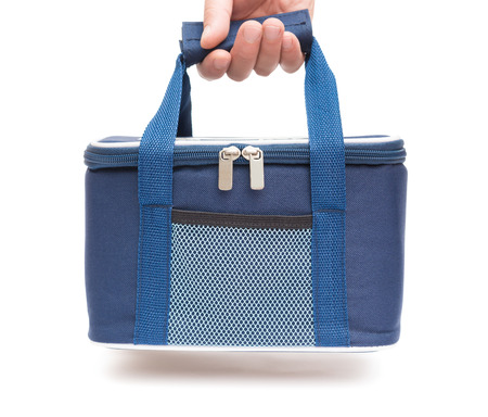 hand carrying a blue lunch pack carrier photo