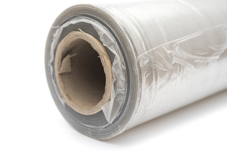 polythene: Roll of wrapping plastic stretch film on white background Stock Photo