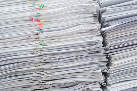 stack of documents: Pile of documents on desk stack up high