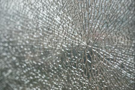 broken glass window: pattern of a broken glass window Stock Photo