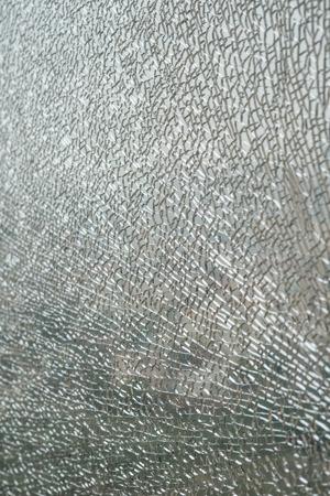 broken glass window: pattern of a broken glass window vertical Stock Photo