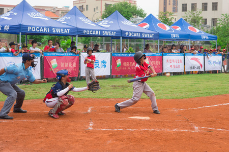 baseman: ZHONGSHAN, GUANGDONG - July 23:batter of team WuXi Experimental Primary School about to hit the ball during a match of 2015 National Baseball Championship. Group A of Panda Cup against Sports East Road Primary School on July 23, 2015.