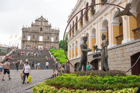 june 25: Macao, China - June 25, 2015:Tourists visit the Historic Center of Macao on June 25, 2015 in Macao, China.