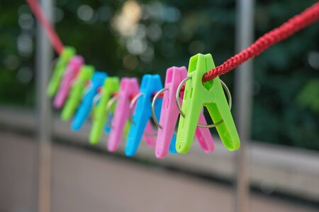 clothespeg: clothespins hanging on rope Stock Photo