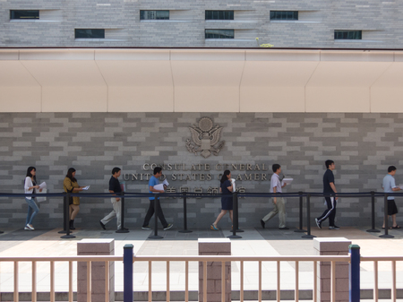 foreign nation: GUANGZHOU, CHINA - September 4 USA consulate on September 4, 2014 in Guangzhou, China. People standing in a queue in front of The Consulate General of United States, applying USA Visas.