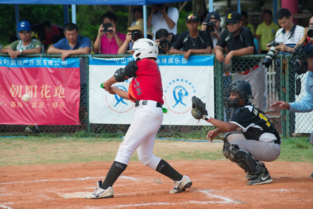 baseman: ZHONGSHAN PANDA CUP, ZHONGSHAN, GUANGDONG - August 4:batter of team TaiWan Zhanghua Dongshan Primary School about to hit the ball during a match of 2015 National Baseball Championship of Panda Cup against WuXi Experimental Primary School on August 4, 2015