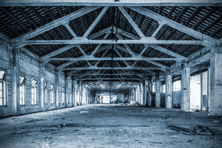 Empty industrial loft in an architectural background
