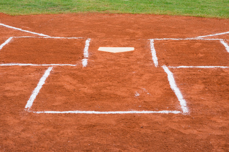 baseball catcher: base of a baseball field