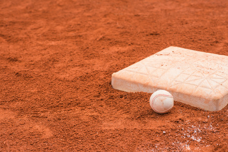 baseball catcher: baseball and base on baseball field Stock Photo
