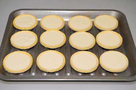 tarts: making egg tarts Stock Photo