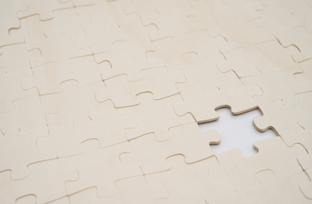 complete solution: jigsaw puzzle with one piece missed on white background Stock Photo
