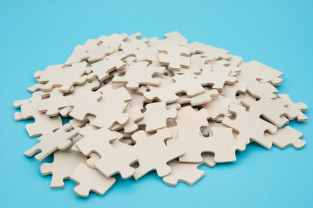 difficult to find: jigsaw puzzle on   blue background Stock Photo