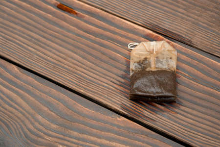 used teabag on a wooden background