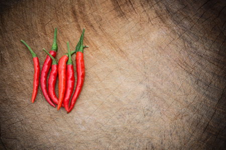 flavorings: fresh and spicy cayenne on a wooden chop board