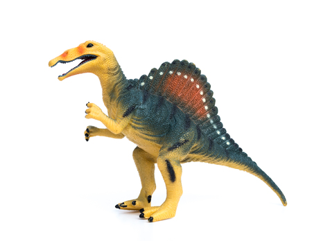 spinosaurus toy on a white background