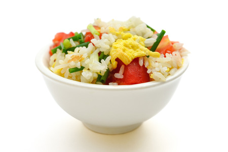 chinese food: chinese cuisine - homemade fried rice with tomatoes and egg on white with clipping path Stock Photo