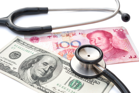 rmb: usd and rmb with stethoscope