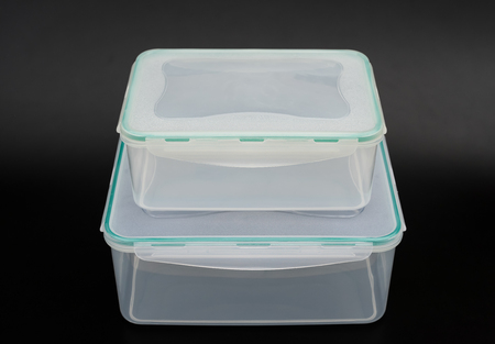 boxes stack: translucent storage boxes stack up on a black background