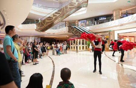 macao: Macao, China - June 25, 2015:tourists watching the dancing performers in a hotels in New Sands Macao, Macao on June 25, 2015.