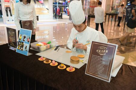 macao: Macao, China - June 25, 2015:master making cartoon characters by chocolate in a hotel in New Sands Macao, Macao on June 25, 2015.