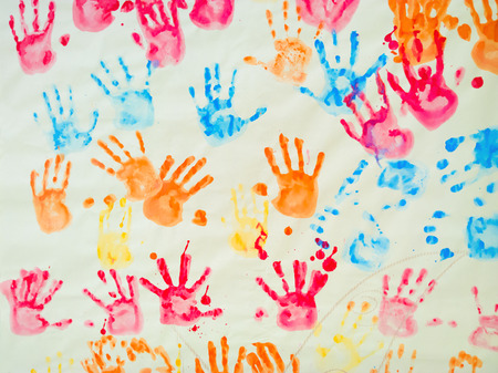 hand colored: colorful hand prints of kids