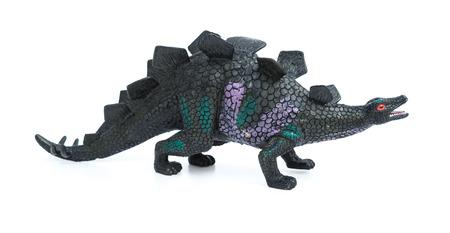 stegosaurus: juguete estegosaurio sobre un fondo blanco