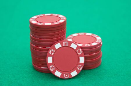 casino table: lots of red poker chips on casino table
