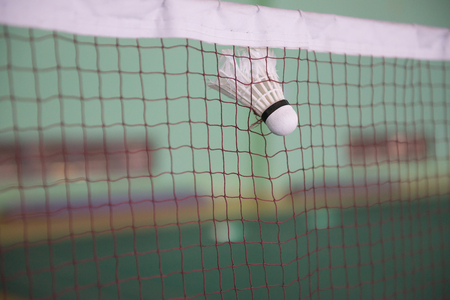 seized: shuttlecock seized by the net in a badminton courts Stock Photo