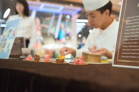june 25: Macau, China - June 25, 2015:master making cartoon characters by chocolate in a hotel in New Sands Macau on June 25, 2015.